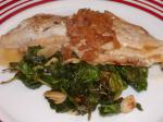 American Pan Fried Tilapia With Lime Basil Beurre Blanc on a Bed of Wilt Dinner