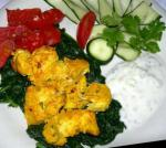 American Chicken Tikka With Baby Spinach and Tomatoes Appetizer