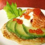Russian Blinis pancakes of Salmon Avocado and Wasabi Appetizer