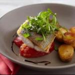 American Crisp Fillet of Sea Bass with Tomatoes Basil Rocket and New Potato Salad Appetizer