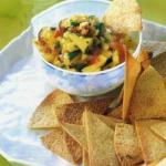 British Crisps Tortilla with Salsa from Fresh Mango and Tomatoes Appetizer