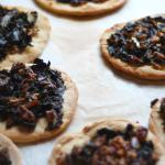 Spanish Spanish Coca With Wilted Green Walnuts and Raisins Appetizer