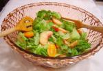 American Garden Greens With Yellow Tomatoes and Peaches Appetizer
