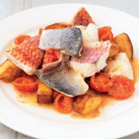 Portuguese Fish with Tomatoes Potatoes and Onions Dinner